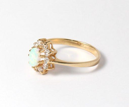 arany női gyűrű opállal virág formában